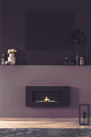 Fireplace in dark living room interior with mockup of empty poster above shelf with flowers