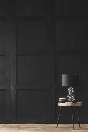 Lamp on wooden table in black empty living room interior with copy space Stok Fotoğraf