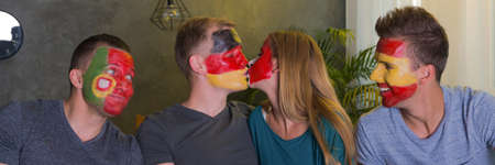 Positive international friends and sport - kissing opponent fan