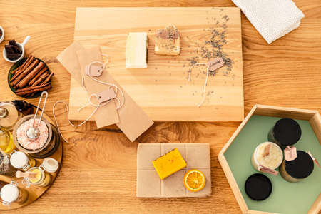 Top view of wooden worktable with citrus, cinnamon and other natural ingredients