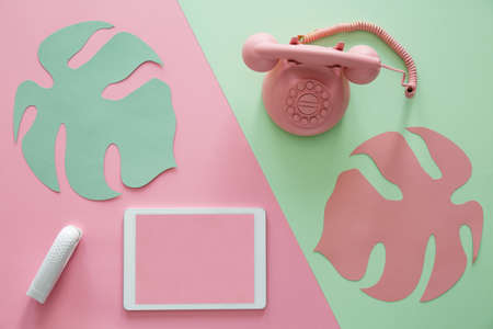 Mockup of tablet on pink background and phone on green background