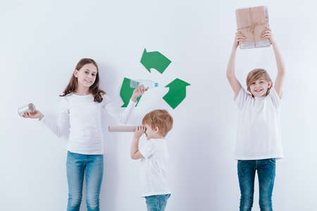Kids playing with paper, metal and plastic waste, promoting recycling on white background