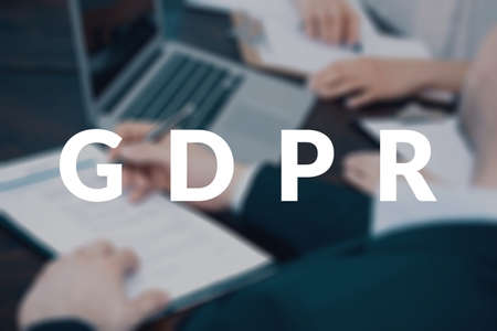 Coworkers working together to form a plan for implementation of the new data protection regulation in a firm. GDPR concept Stock Photo