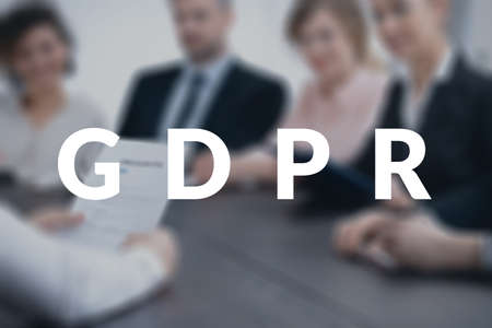 Team of coworkers discussing the new data protection legislation during a business meeting. GDPR concept