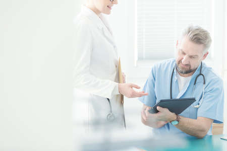 General practitioner consulting on a medical case with a specialist Stock Photo