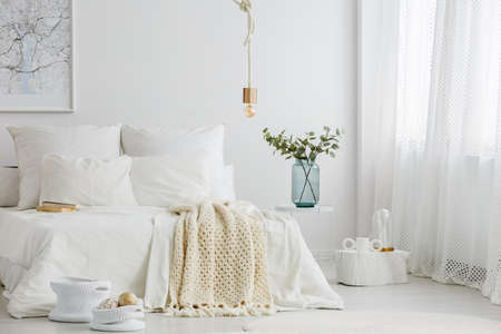 Spacious scandi bedroom interior with big window and minimalist decoration Stock Photo