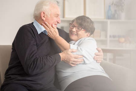Love in retirement home between two happy seniors