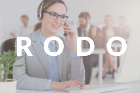 Call center employee calling a business owner with an offer of a course on RODO. White text on blurred photo Stock Photo