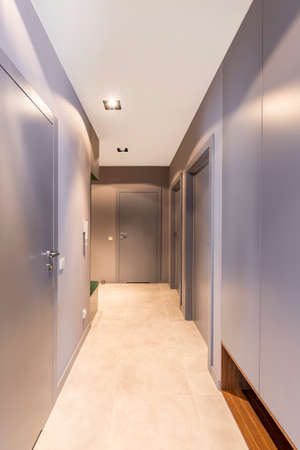 Grey doors in the hall of a hotel interior with lights
