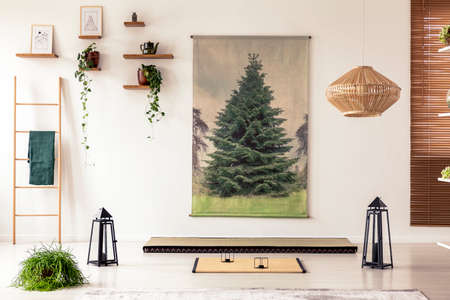 Black lanterns, wooden ladder, tatami mat and tree graphic in minimal interior with asian design. Real photo Stock Photo