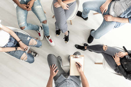 Top view of a group therapy session for teenagers struggling with depression Stockfoto