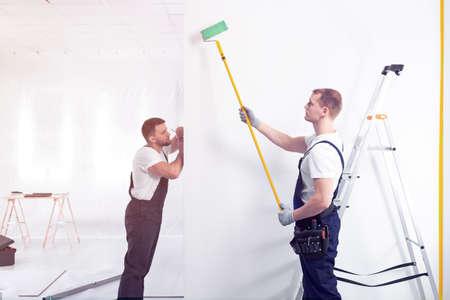 Decorateurs schilderen een muur met een roller tijdens kantoorrenovatie Stockfoto
