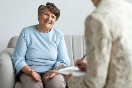 Elderly woman talking to a financial advisor about a loan during appointment