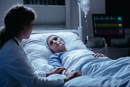 Nurse supporting weak elderly woman during treatment in the hospital Stock fotó - 105628915