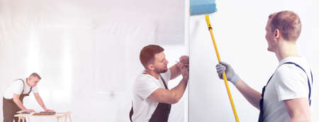 Professional painter painting a wall blue with a roller, contractor taking measurements and a carpenter cutting plywood with a saw Stok Fotoğraf