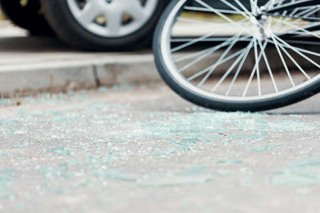 Broken glass on the street after a car accident with cyclist
