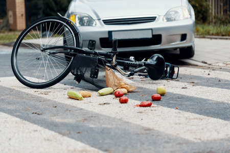 Fatal traffic accident between car and bicycle on a pedestrian crossing Stock Photo - 106516567