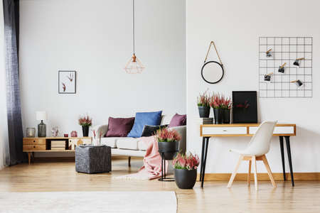 Modern living room and home office interior decorated with heather