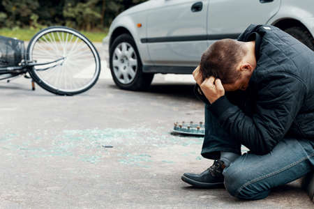 Irresponsible car driver after dangerous incident on the road with cyclist