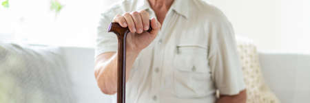 Panorama and close-up of senior person with walking stick. Blurred background Stock Photo - 107030970