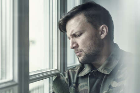 Sad and lonely soldier in depression after war with emotional problem Stock Photo