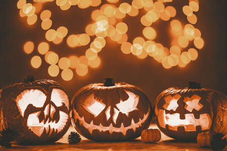 Three spooky pumpkin jack-o-lanterns made for halloween Stock fotó