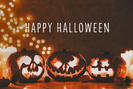 Caption Happy Halloween on the photo of three creepy pumpkins lanterns carved for halloween Stock fotó - 109107870