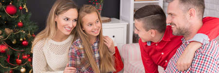 Family time at christmassy decorated home interior Stock Photo