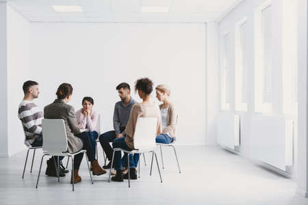 Group psychotherapy in white interior Stock Photo
