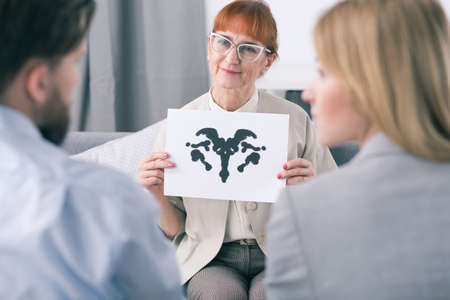 Therapist doing an inkblot test with her patients
