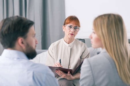 Mediator talking to a couple during a session Stock Photo