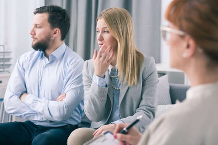 Married couple showing ignorance during a therapy session with a psychologist Stock Photo