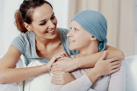 Woman showing support to her sister with cancer Banco de Imagens