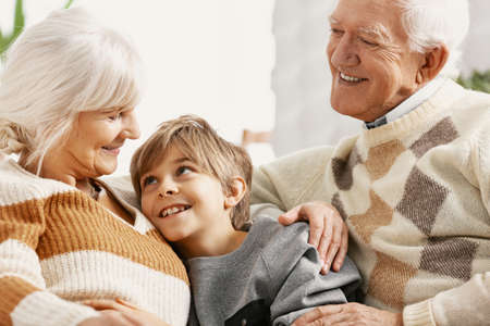 Loving grandparents spending time with teenage grandson Stock Photo