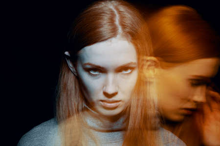 Multiple exposure of beautiful redhead young woman feeling grief and sorrow