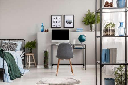 Urban jungle in elegant grey bedroom interior designed for teenager