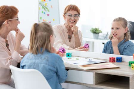 Speech therapist during a treatment with a child 스톡 콘텐츠