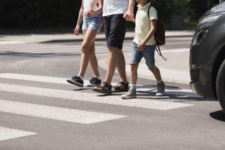 Children crossing the street with their father Banco de Imagens