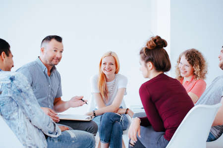 Group of teenagers during psychotherapy with professional counselor