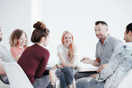 Group of teenagers during psychotherapy with professional therapist