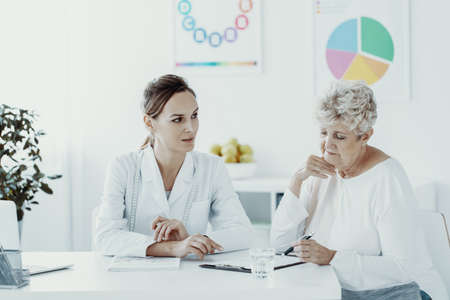 Senior woman and dietician during a consultation Stock Photo
