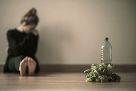 Teenager girl with anorexia nervosa being on restricted diet of water and salad Stok Fotoğraf