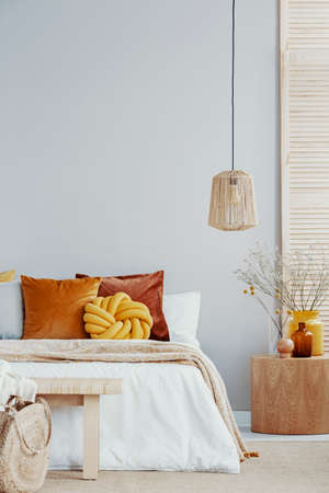 Natural style bedroom with decorations in yellow and orange color