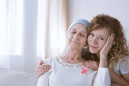 Beautiful daughter supporting mother with breast cancer Stock Photo