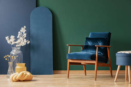 Retro dark blue armchair in elegant, living room interior with copy space on empty green and blue wall Stok Fotoğraf