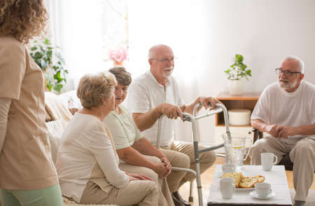 Group of seniors having a conversation in a nursing home