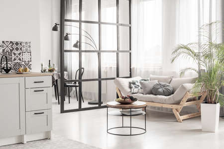 Open space kitchen and living room interior with mullions wall and scandinvian design Фото со стока