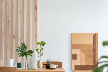 Fashionable scandinavian wooden design in bright living room interior