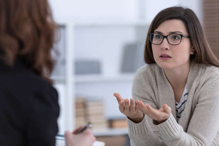 Woman with problem and supporting counselor during therapy session Banco de Imagens