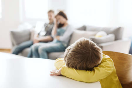 helpless parents and their badly behaving son at home Stock Photo